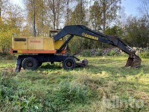 колесный экскаватор AKERMAN H9MB